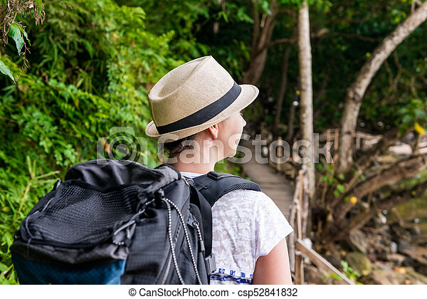 woman hiker in hike with a big backpack back view - csp52841832