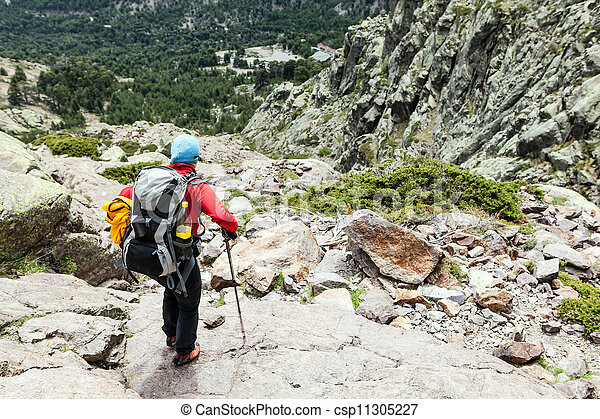 Woman hiking with backpack in Corsica mountains - csp11305227