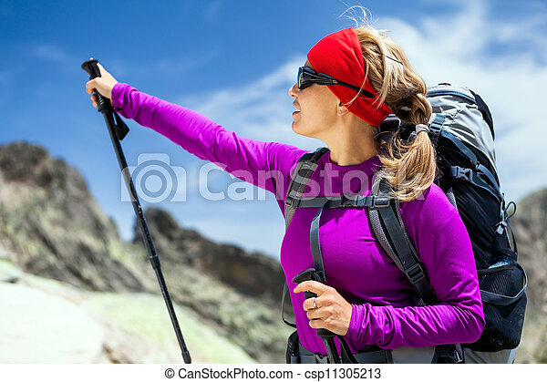 Woman hiking with backpack in mountains - csp11305213