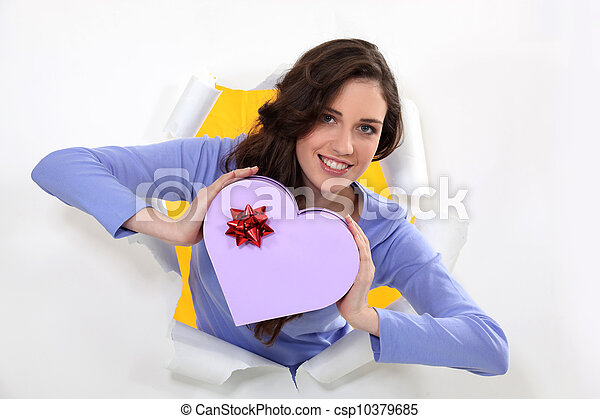 woman holding a box shaped as a hearth - csp10379685