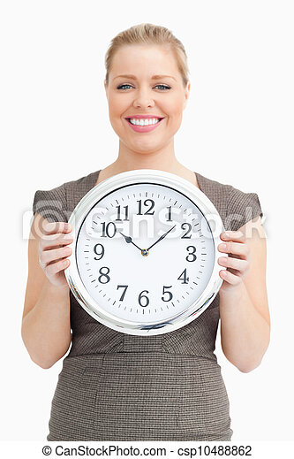 Woman holding a clock in her hands - csp10488862