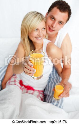Woman holding a glass of orange juice - csp2446176