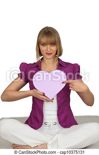 Woman holding a heart-shaped box - csp10375131