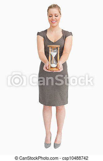 Woman holding a hourglass - csp10488742