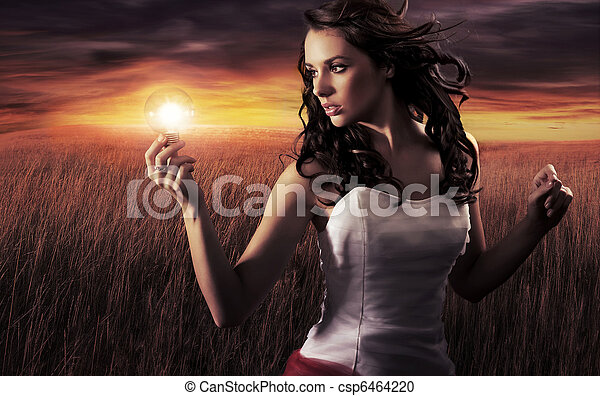 Woman holding a light bulb - csp6464220