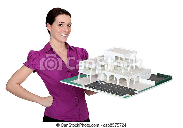 woman holding a model of a building - csp8575724