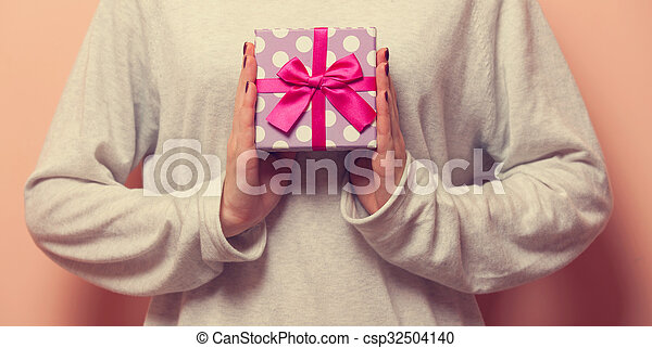 Woman holding a present box - csp32504140