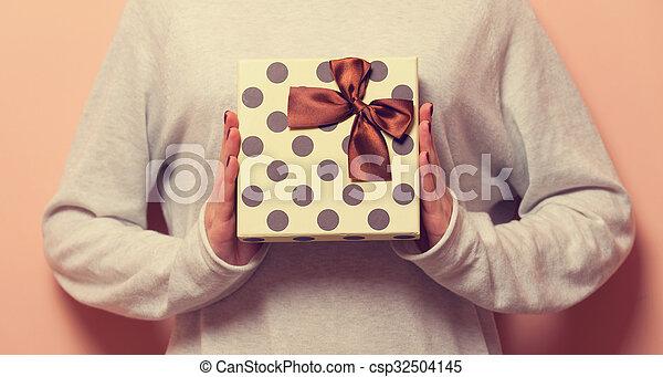 Woman holding a present box - csp32504145