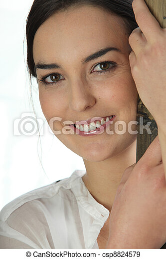 Woman holding a wooden pole - csp8824579