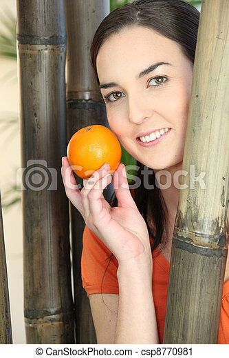 Woman holding an orange - csp8770981
