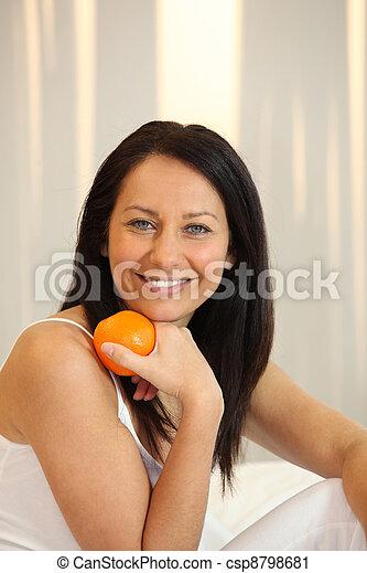 Woman holding an orange - csp8798681