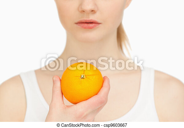 Woman holding an orange - csp9603667