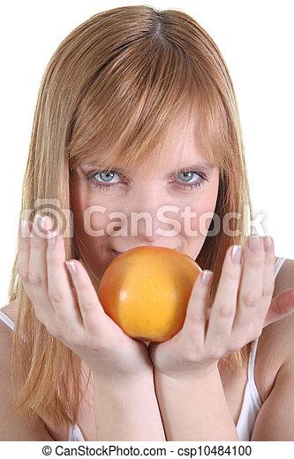 Woman holding an orange - csp10484100