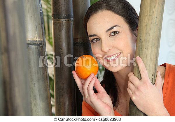 Woman holding an orange - csp8823963
