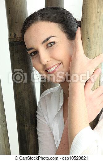 Woman holding bamboo - csp10520821