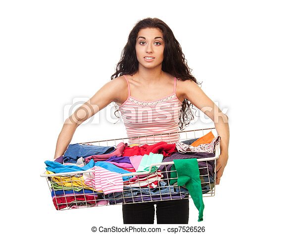 Woman holding basket of clothes - csp7526526
