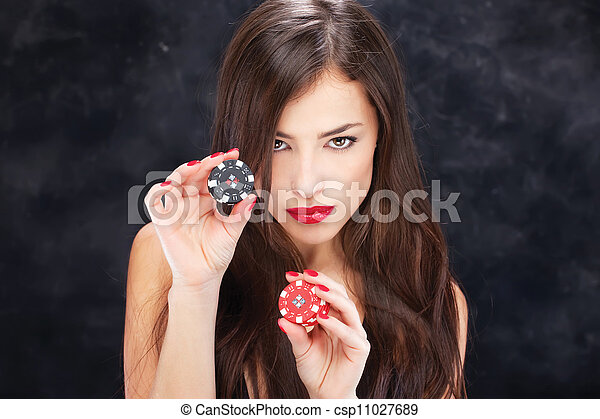 woman holding chips for gambling - csp11027689
