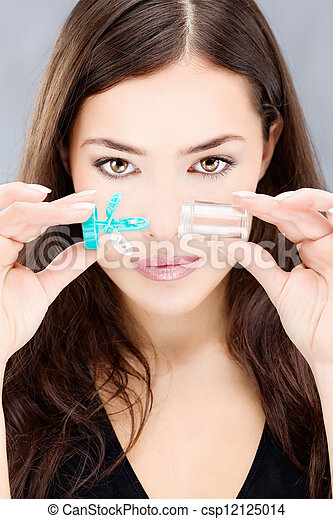 woman holding contact lenses wash case - csp12125014