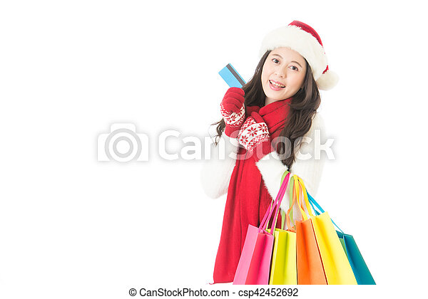 10bc8b3e11f4f Woman holding credit card for winter christmas shopping. Woman ...