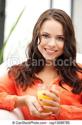 woman holding glass of orange juice - csp13088785