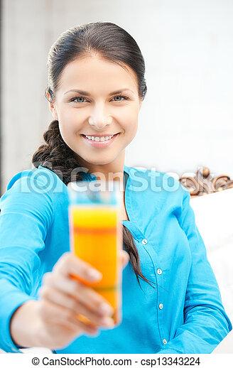 woman holding glass of orange juice - csp13343224