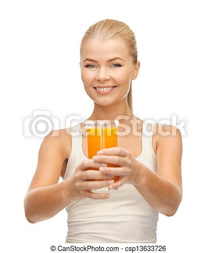 woman holding glass of orange juice - csp13633726