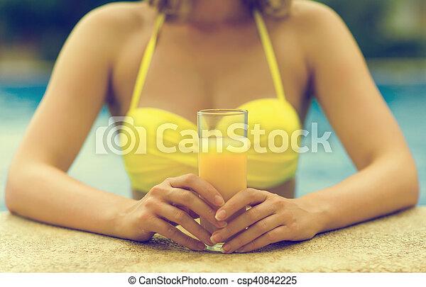 Woman holding glass of orange juice. - csp40842225