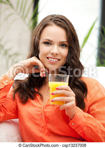 woman holding glass of orange juice - csp13237008