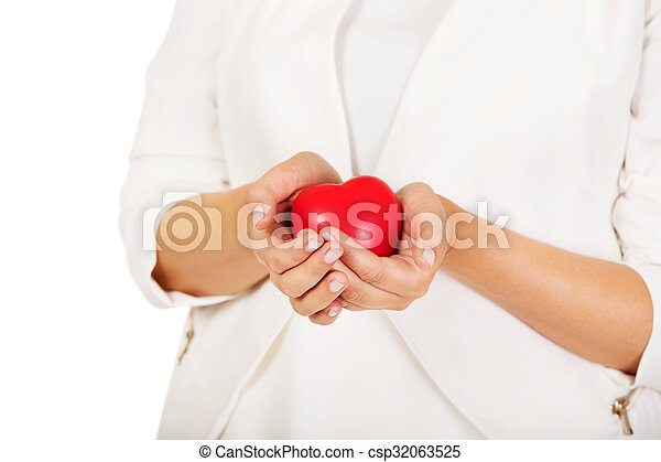 Woman holding heart shaped toy - csp32063525