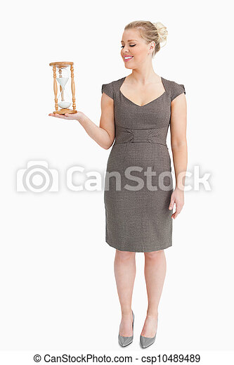 Woman holding in her hand a hourglass - csp10489489