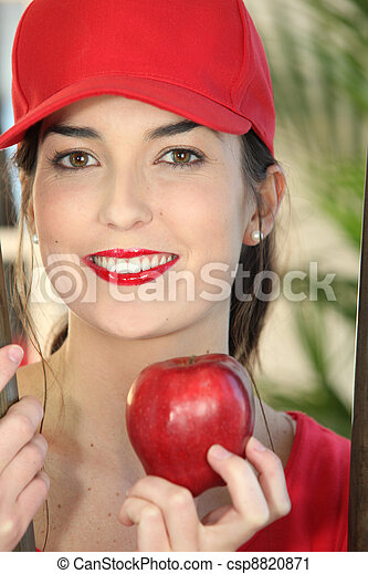 Woman holding red apple - csp8820871