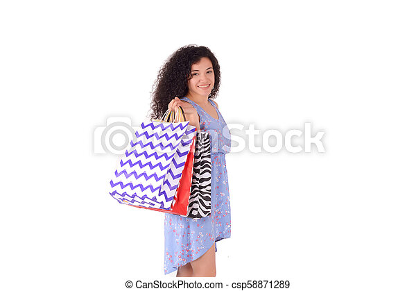 Woman holding shopping bags - csp58871289