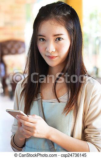 woman holding smart phone - csp24736145