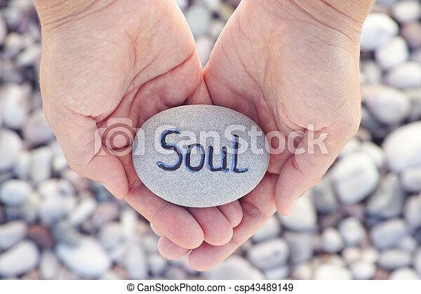 Woman holding stone with the word Soul in her palms - csp43489149