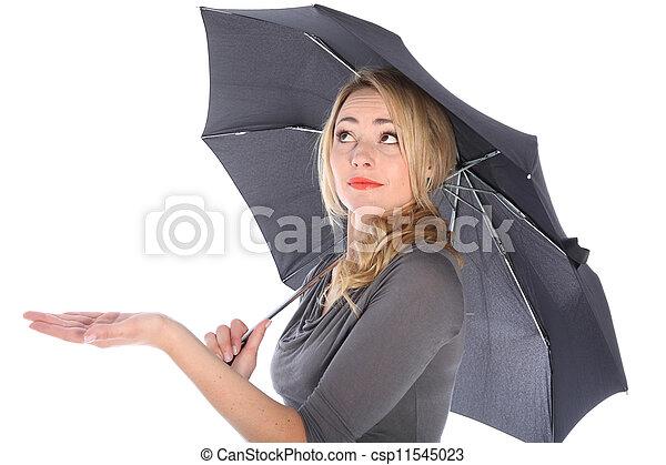 Woman Holding Umbrella Looking Up - csp11545023