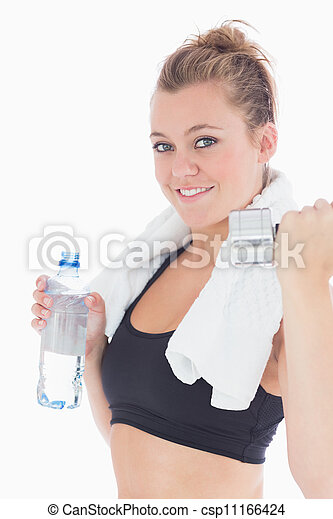 Woman holding weights and a bottle of water - csp11166424