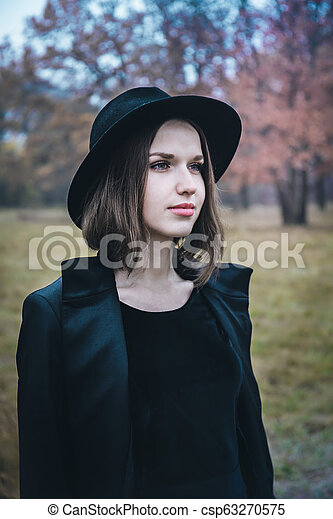 woman in a black hat - csp63270575
