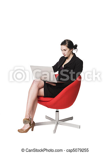 Woman in a chair with a computer - csp5079255