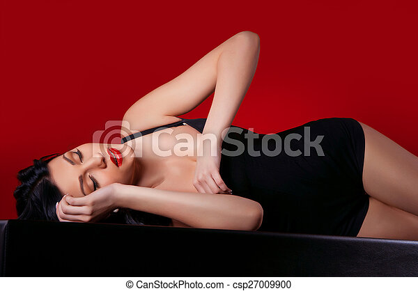 woman in a dark dress - csp27009900