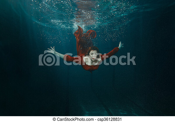 Woman in a dress dives. - csp36128831