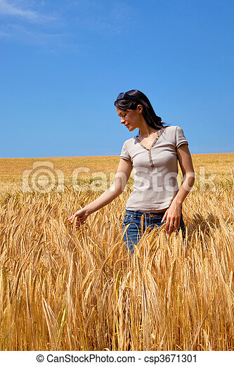 Woman in a field of barley - csp3671301
