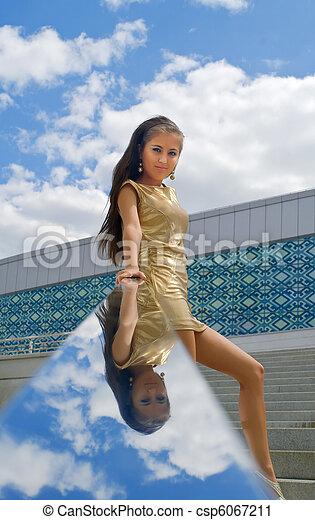 woman in a golden dress - csp6067211