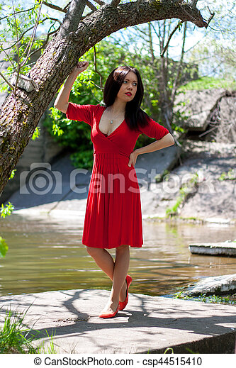Woman in a red dress - csp44515410