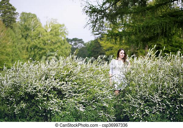 woman in a spirea bush - csp36997336