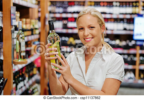 woman in a supermarket wine shelf - csp11137862