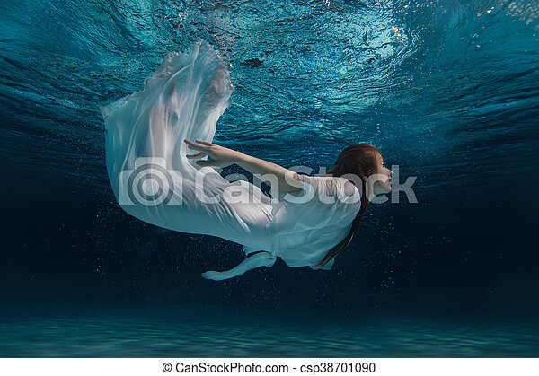 Woman in a white dress under water. - csp38701090