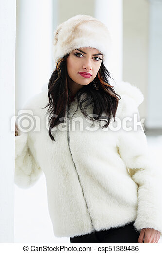 Woman in a white fur coat and hat - csp51389486