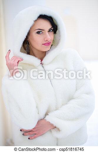 Woman in a white fur coat - csp51816745