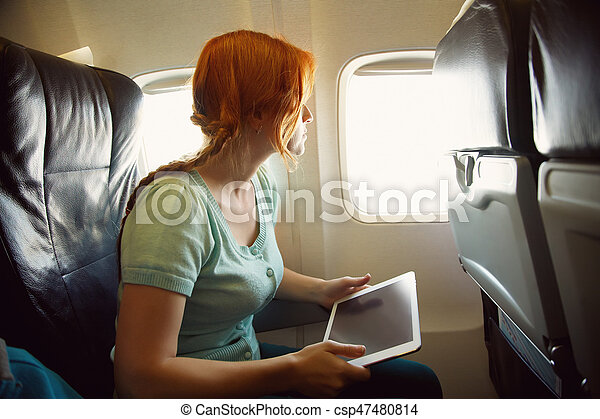 woman in an airplane - csp47480814