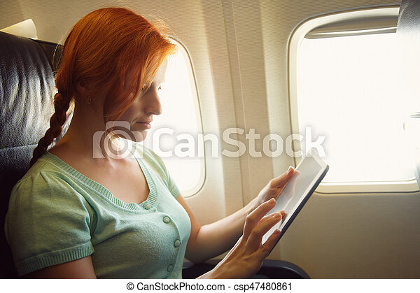 woman in an airplane - csp47480861